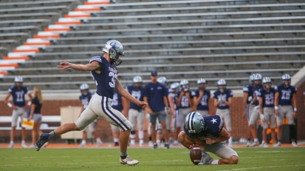 Farragut's Daniel Bethel (32) punts the ball during the Knoxville Orthopaedic Clinic Kickoff Classic at Neyland Stadium in Knoxville Friday, August 16, 2019. Jamboree 60