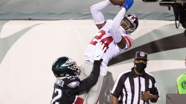 Oct 22, 2020; Philadelphia, Pennsylvania, USA; New York Giants cornerback James Bradberry (24) intercepts the ball in front of Philadelphia Eagles wide receiver John Hightower (82) during the second quarter at Lincoln Financial Field.