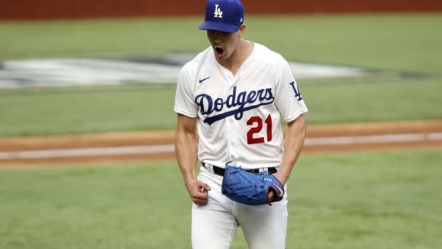 Oct 17, 2020; Arlington, Texas, USA; Los Angeles Dodgers starting pitcher Walker Buehler (21) reacts after a strike out in the sixth inning against the Atlanta Braves during game six of the 2020 NLCS at Globe Life Field. Mandatory Credit: Tim Heitman-USA TODAY Sports