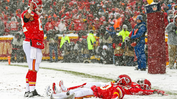 Dec 15, 2019; Kansas City, MO, USA; Kansas City Chiefs wide receiver Sammy Watkins (14) and wide receiver Tyreek Hill (10) celebrate a successful two-point conversion by making snow angels as center Austin Reiter (62) looks on during the second half against the Denver Broncos at Arrowhead Stadium. Mandatory Credit: Jay Biggerstaff-USA TODAY Sports