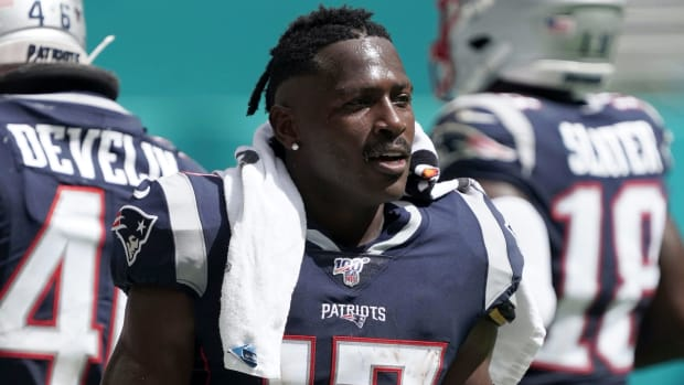 New England Patriots wide receiver Antonio Brown (17) watches from the sidelines in the second half against the Miami Dolphins at Hard Rock Stadium. The Patriots defeated the Dolphins 43-0.