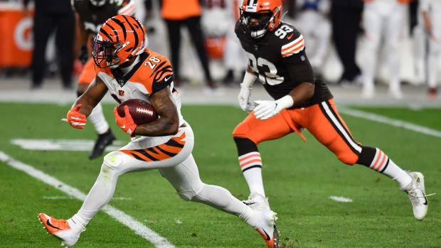 Sep 17, 2020; Cleveland, Ohio, USA; Cincinnati Bengals running back Joe Mixon (28) runs with the ball against Cleveland Browns middle linebacker B.J. Goodson (93) during the first half at FirstEnergy Stadium. Mandatory Credit: Ken Blaze-USA TODAY Sports