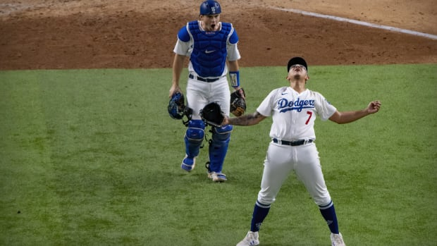 Oct 18, 2020; Arlington, Texas, USA; Los Angeles Dodgers starting pitcher Julio Urias (7) and catcher Will Smith (16) celebrate defeating the Atlanta Braves in game seven of the 2020 NLCS at Globe Life Field. Mandatory Credit: Jerome Miron-USA TODAY Sports