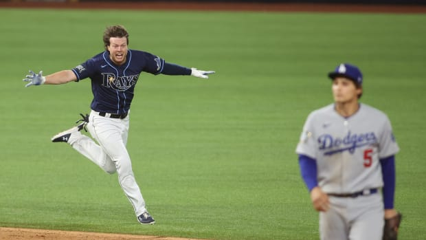 Oct 24, 2020; Arlington, Texas, USA; Tampa Bay Rays right fielder Brett Phillips (14) celebrates after driving in the winning run as Los Angeles Dodgers shortstop Corey Seager (5) looks on during the ninth inning of game four of the 2020 World Series at Globe Life Field. Mandatory Credit: Tim Heitman-USA TODAY Sports