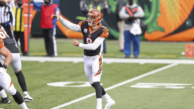 Oct 25, 2020; Cincinnati, Ohio, USA; Cincinnati Bengals quarterback Joe Burrow (9) throws a pass against the Cleveland Browns in the first half at Paul Brown Stadium. Mandatory Credit: Katie Stratman-USA TODAY Sports