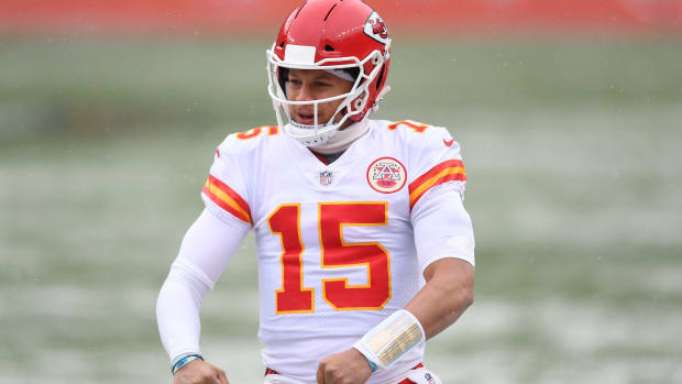 Oct 25, 2020; Denver, Colorado, USA; Kansas City Chiefs quarterback Patrick Mahomes (15) celebrates a score in the first quarter against the Denver Broncos at Empower Field at Mile High. Mandatory Credit: Ron Chenoy-USA TODAY Sports
