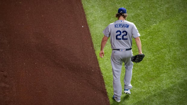 Oct 25, 2020; Arlington, Texas, USA; Los Angeles Dodgers starting pitcher Clayton Kershaw (22) warms up before the game between the Tampa Bay Rays and the Los Angeles Dodgers in game five of the 2020 World Series at Globe Life Field. Mandatory Credit: Jerome Miron-USA TODAY Sports