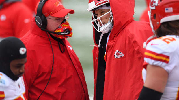 Oct 25, 2020; Denver, Colorado, USA; Kansas City Chiefs head coach Andy Reid speaks to quarterback Patrick Mahomes (15) in the first half against the Denver Broncos at Empower Field at Mile High. Mandatory Credit: Ron Chenoy-USA TODAY Sports