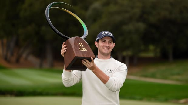 Patrick Cantlay celebrates with the ZOZO trophy after winning the Zozo Championship golf tournament at Sherwood Country Club.