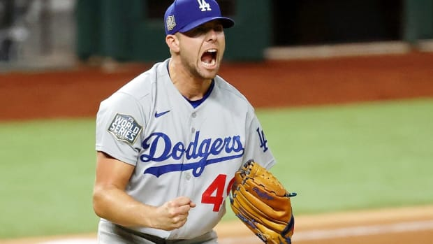 Oct 25, 2020; Arlington, Texas, USA; Los Angeles Dodgers relief pitcher Blake Treinen (49) reacts after striking out Tampa Bay Rays shortstop Willy Adames (not pictured) to end the ninth inning of game five of the 2020 World Series at Globe Life Field. The Los Angeles Dodgers won 4-2. Mandatory Credit: Kevin Jairaj-USA TODAY Sports