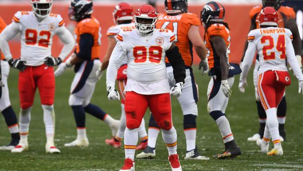 Oct 25, 2020; Denver, Colorado, USA; Kansas City Chiefs defensive tackle Khalen Saunders (99) reacts after his tackle in the second half against the Denver Broncos at Empower Field at Mile High. Mandatory Credit: Ron Chenoy-USA TODAY Sports