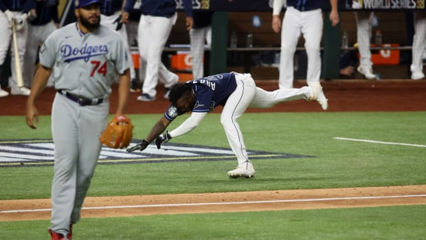 Oct 24, 2020; Arlington, Texas, USA; Tampa Bay Rays designated hitter Randy Arozarena (56) stumbles before scoring the winning run as Los Angeles Dodgers relief pitcher Kenley Jansen (74) looks on during the ninth inning of game four of the 2020 World Series at Globe Life Field. Mandatory Credit: Tim Heitman-USA TODAY Sports