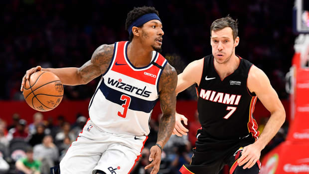 Washington Wizards guard Bradley Beal dribbles past Miami Heat guard Goran Dragic.