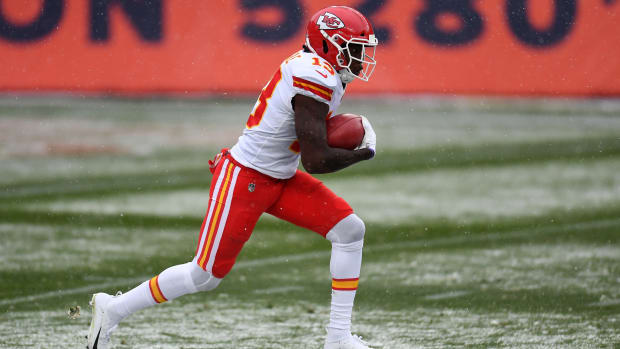 Oct 25, 2020; Denver, Colorado, USA; Kansas City Chiefs wide receiver Byron Pringle (13) returns a punt for a touchdown in the first half against the Denver Broncos at Empower Field at Mile High. Mandatory Credit: Ron Chenoy-USA TODAY Sports