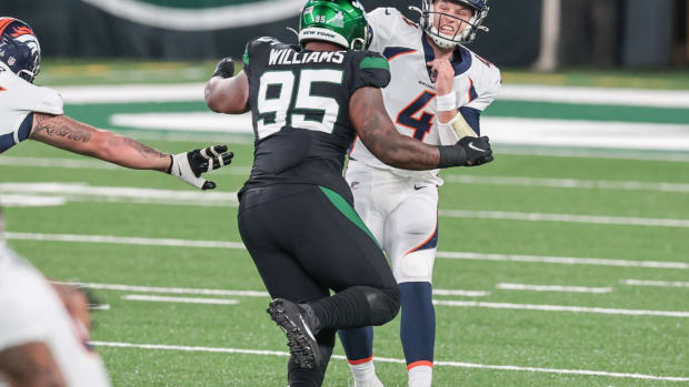 Denver Broncos quarterback Brett Rypien (4) throws the ball as New York Jets defensive tackle Quinnen Williams (95) is blocked by offensive guard Dalton Risner (66) during the first half at MetLife Stadium.