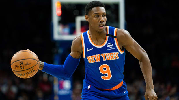 New York Knicks guard RJ Barrett passes the ball against the Philadelphia 76ers