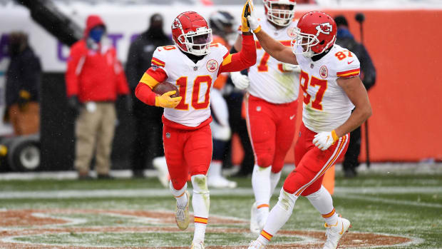 Oct 25, 2020; Denver, Colorado, USA; Kansas City Chiefs wide receiver Tyreek Hill (10) celebrates his score with tight end Travis Kelce (87) in the second half at Empower Field at Mile High. Mandatory Credit: Ron Chenoy-USA TODAY Sports
