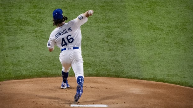 Oct 21, 2020; Arlington, Texas, USA; Los Angeles Dodgers starting pitcher Tony Gonsolin (46) pitches against the Tampa Bay Rays during the first inning in game two of the 2020 World Series at Globe Life Field. Mandatory Credit: Jerome Miron-USA TODAY Sports