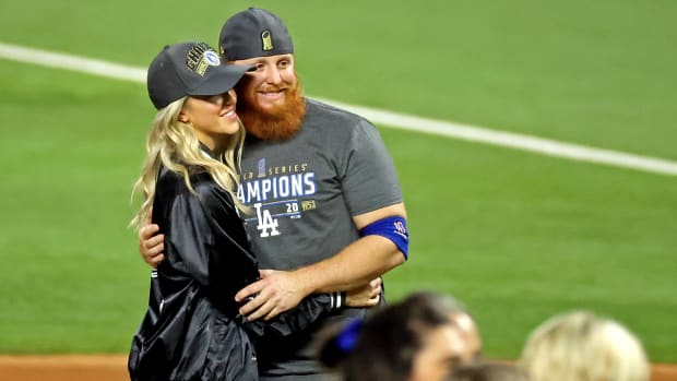 Dodgers' Justin Turner on the field with his wife celebrating World Series win