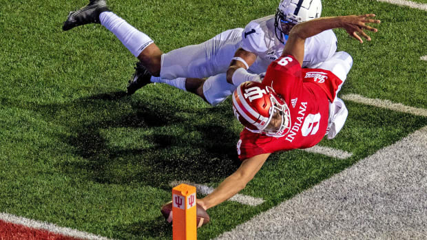 Indiana QB Michael Penix Jr leaps for the pylon for a game-winning two-point conversion