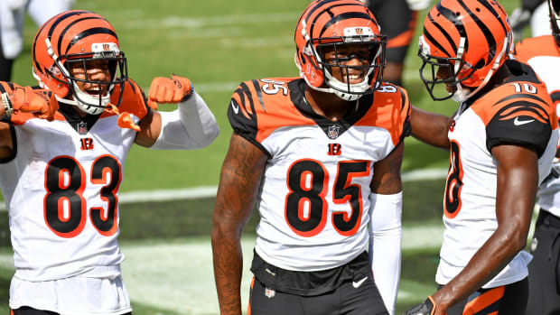 Sep 27, 2020; Philadelphia, Pennsylvania, USA; Cincinnati Bengals wide receiver Tee Higgins (85) celebrates his touchdown catch with wide receiver Tyler Boyd (83) and wide receiver A.J. Green (18) against the Philadelphia Eagles during the second quarter at Lincoln Financial Field. Mandatory Credit: Eric Hartline-USA TODAY Sports