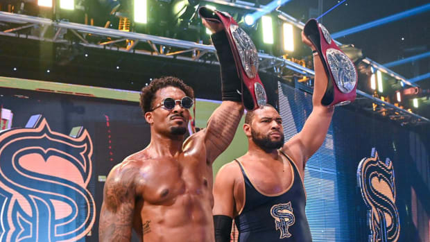 The Street Profits (Angelo Dawkins and Montez Ford) celebrate after defending their WWE Raw tag team titles