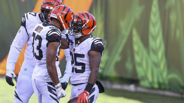 Nov 1, 2020; Cincinnati, Ohio, USA; Cincinnati Bengals running back Giovani Bernard (25) celebrates with wide receiver Tyler Boyd (83) after scoring a touchdown against the Tennessee Titans in the first half at Paul Brown Stadium. Mandatory Credit: Katie Stratman-USA TODAY Sports