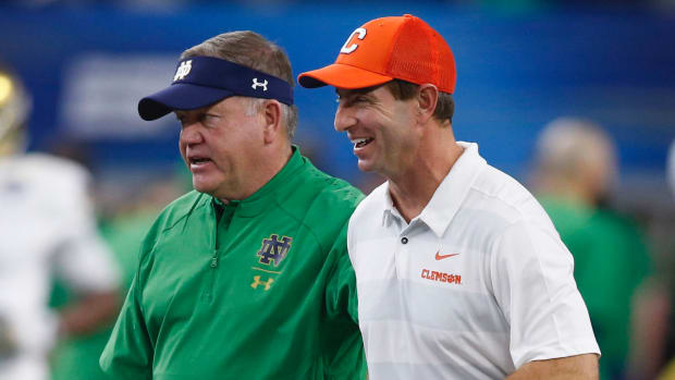 Clemson Tigers head coach Dabo Swinney (right) greets Notre Dame Fighting Irish head coach Brian Kelly before 2018 Cotton Bowl college football playoff semifinal game at AT&T Stadium.