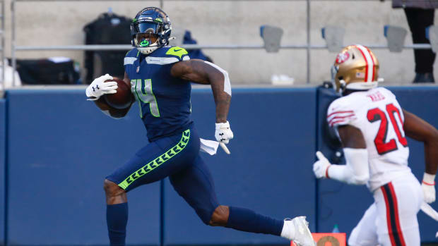 Seattle Seahawks wide receiver DK Metcalf (14) catches a touchdown pass against the San Francisco 49ers during the first quarter at CenturyLink Field.