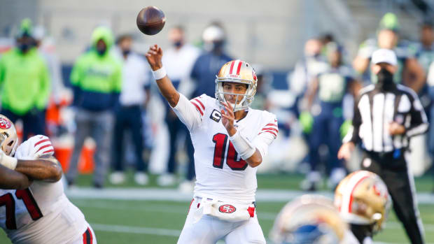 San Francisco 49ers quarterback Jimmy Garoppolo (10) passes against the Seattle Seahawks during the second quarter at CenturyLink Field.