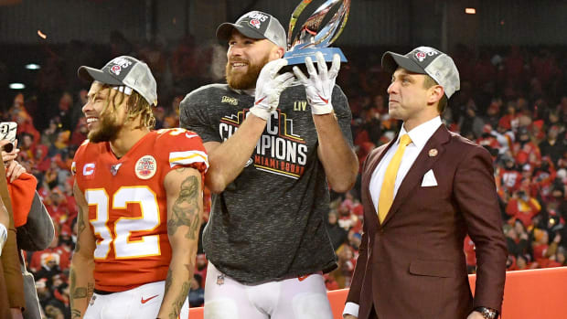Jan 19, 2020; Kansas City, Missouri, USA; Kansas City Chiefs strong safety Tyrann Mathieu (32) and tight end Travis Kelce (87) and general manager Brett Veach (left to right) celebrate on stage after the AFC Championship Game against the Tennessee Titans at Arrowhead Stadium. Mandatory Credit: Denny Medley-USA TODAY Sports