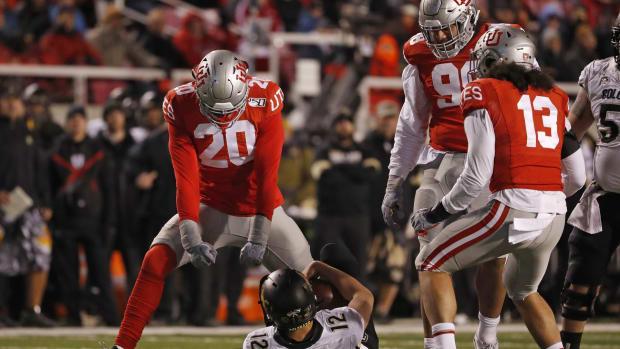 Nov 30, 2019; Salt Lake City, UT, USA; Utah Utes linebacker Devin Lloyd (20) reacts after taking down Colorado Buffaloes quarterback Steven Montez (12) in the fourth quarter at Rice-Eccles Stadium.