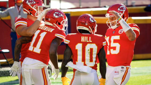 Nov 1, 2020; Kansas City, Missouri, USA; Kansas City Chiefs wide receiver Demarcus Robinson (11) is congratulated by quarterback Patrick Mahomes (15) and tight end Nick Keizer (48) and wide receiver Tyreek Hill (10) after scoring a touchdown against the New York Jets during the second half at Arrowhead Stadium. Mandatory Credit: Jay Biggerstaff-USA