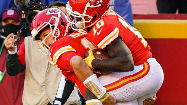 Nov 1, 2020; Kansas City, Missouri, USA; Kansas City Chiefs quarterback Patrick Mahomes (15) carries wide receiver Tyreek Hill (10) off the field after he was injured while scoring a touchdown against the New York Jets during the second half at Arrowhead Stadium. Mandatory Credit: Jay Biggerstaff-USA TODAY Sports