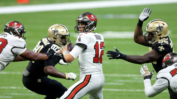 New Orleans Saints defensive end Carl Granderson (96) pressures Tampa Bay Buccaneers quarterback Tom Brady (12) during the fourth quarter at the Mercedes-Benz Superdome.