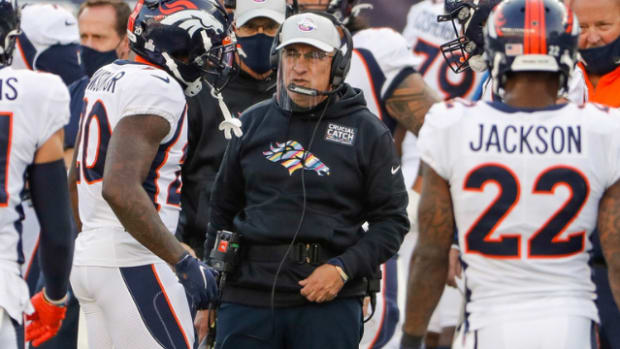 Oct 18, 2020; Foxborough, Massachusetts, USA; Denver Broncos head coach Vic Fangio talks with cornerback Duke Dawson Jr. (20) during the second half against the New England Patriots at Gillette Stadium.