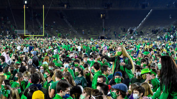 Fans storm the field after the Notre Dame Fighting Irish defeated the Clemson Tigers 47-40 in two overtimes.