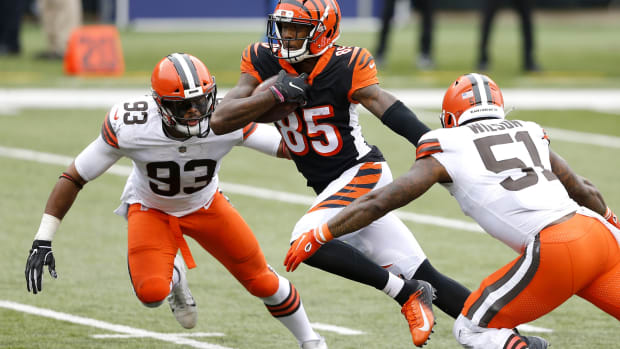 Oct 25, 2020; Cincinnati, Ohio, USA; Cincinnati Bengals wide receiver Tee Higgins (85)breaks past Cleveland Browns middle linebacker B.J. Goodson (93)and linebacker Mack Wilson (51) for the touchdown late in the fourth quarter at Paul Brown Stadium. Mandatory Credit: Joseph Maiorana-USA TODAY Sports