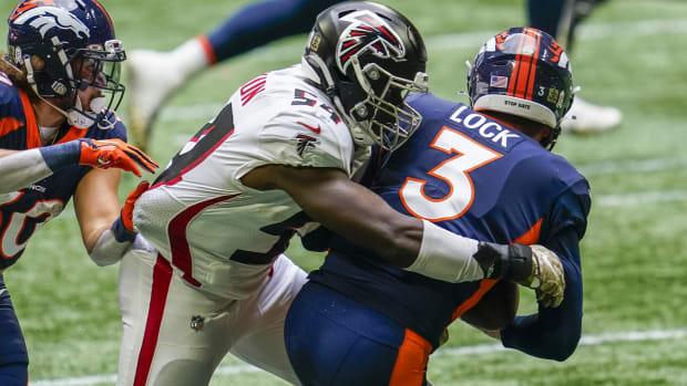 Atlanta Falcons linebacker Foyesade Oluokun (54) tackles Denver Broncos quarterback Drew Lock (3) for a loss during the first half at Mercedes-Benz Stadium.