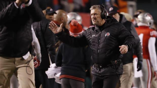 Nov 30, 2019; Salt Lake City, UT, USA; Utah Utes head coach Kyle Whittingham celebrates after a third quarter touchdown against the Colorado Buffaloes at Rice-Eccles Stadium.