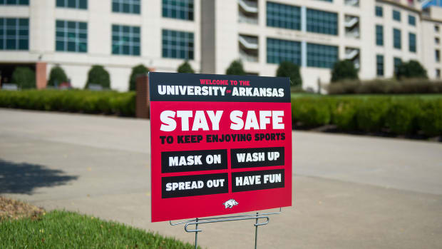 "A sign at Arkansa warns students to stay safe ""to keep enjoying sports"""