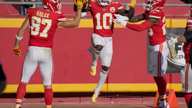 Nov 8, 2020; Kansas City, Missouri, USA; Kansas City Chiefs wide receiver Tyreek Hill (10) celebrates with tight end Travis Kelce (87) and running back Clyde Edwards-Helaire (25) after scoring against the Carolina Panthers during the second half at Arrowhead Stadium. Mandatory Credit: Denny Medley-USA TODAY Sports