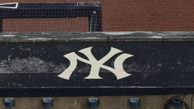 Yankees logo on top of the dugout in the rain
