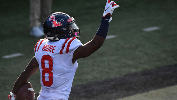 Mississippi Rebels wide receiver Elijah Moore (8) celebrates after a touchdown against the Vanderbilt Commodores during the first half at Vanderbilt Stadium. Mandatory Credit: Christopher Hanewinckel-USA TODAY Sports