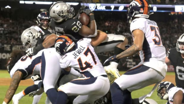 Sep 9, 2019; Oakland, CA, USA; Oakland Raiders running back Josh Jacobs (28) scores on a 2-yard touchdown run in the second quarter against the Denver Broncos at Oakland-Alameda County Coliseum.