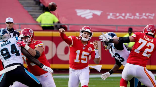 Nov 8, 2020; Kansas City, Missouri, USA; Kansas City Chiefs quarterback Patrick Mahomes (15) throws a pass against the Carolina Panthers during the first half at Arrowhead Stadium. Mandatory Credit: Denny Medley-USA TODAY Sports