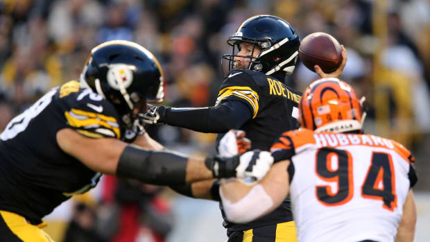 Pittsburgh Steelers quarterback Ben Roethlisberger (7) drops back to throw as Cincinnati Bengals defensive end Sam Hubbard (94) applies pressure in the first quarter of a Week 17 NFL football game, Sunday, Dec. 30, 2018, at Heinz Field in Pittsburgh. The Cincinnati Bengals lead 10-3 at halftime. Cincinnati Bengals At Pittsburgh Steelers 12 30 2018