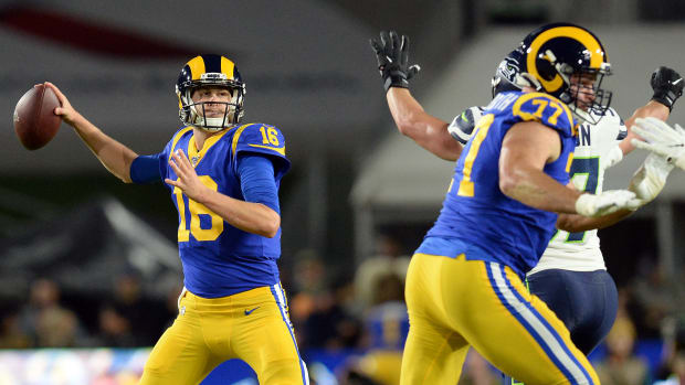 Los Angeles Rams quarterback Jared Goff (16) throws as offensive tackle Andrew Whitworth (77) provides coverage against the Seattle Seahawks during the first half at the Los Angeles Memorial Coliseum.