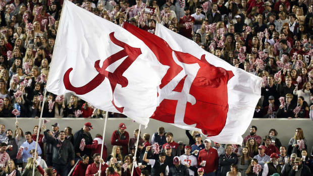 Alabama Crimson Tide flags fly at a 2019 game