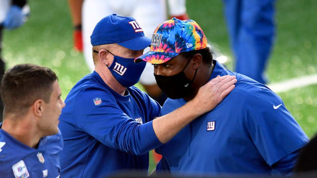 New York Giants offensive coordinator Jason Garrett, left, and defensive coordinator Patrick Graham hug after the Giants' first win of the season. The New York Giants defeat the Washington Football Team, 20-19, at MetLife Stadium on Sunday, Oct. 18, 2020, in East Rutherford.